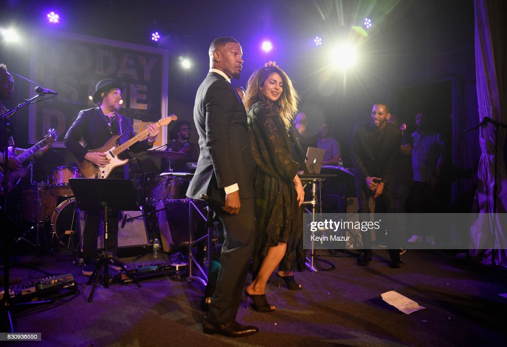 Jamie Foxx and Priyanka Chopra perform onstage at Apollo in the Hamptons 2017: hosted by Ronald O. Perelman at The Creeks on August 12, 2017 in East Hampton, New York.