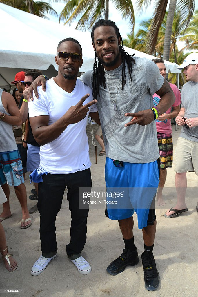Jamie Foxx and Richard Sherman attend Chefs Models Volleyball Tournament during the Food Network South Beach Wine Food Festival on February 20 2014...