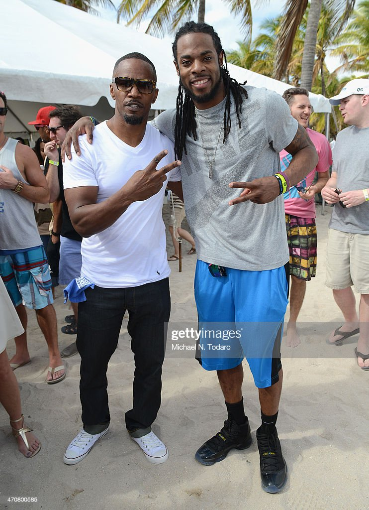 Jamie Foxx and Richard Sherman attend Chefs + Models Volleyball Tournament during the Food Network South Beach Wine & Food Festival on February 20, 2014 in Miami, Florida.