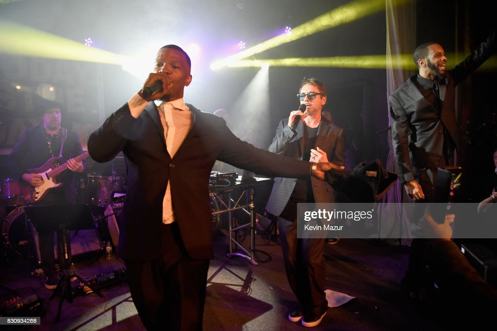 Jamie Foxx and Robert Downey Jr. perform onstage at Apollo in the Hamptons 2017: hosted by Ronald O. Perelman at The Creeks on August 12, 2017 in East Hampton, New York.