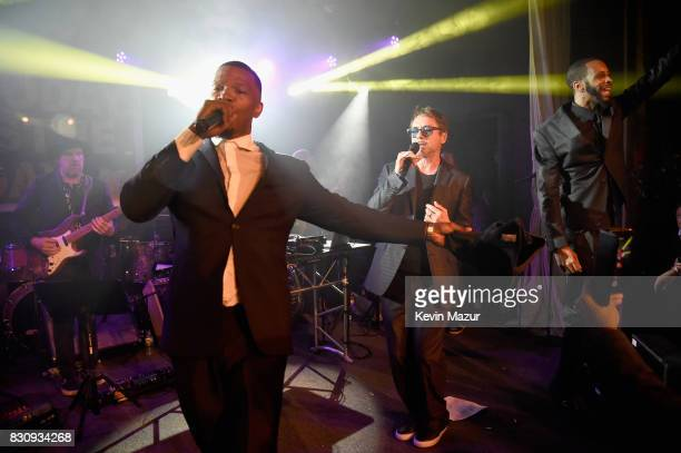 Jamie Foxx and Robert Downey Jr perform onstage at Apollo in the Hamptons 2017 hosted by Ronald O Perelman at The Creeks on August 12 2017 in East...