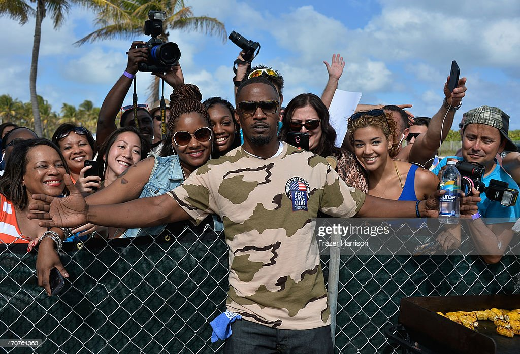 <a gi-track='captionPersonalityLinkClicked' href=/galleries/search?phrase=Jamie+Foxx&family=editorial&specificpeople=201715 ng-click='$event.stopPropagation()'>Jamie Foxx</a> attends Sports Illustrated Swimsuit Beach Volleyball Tournament on Ocean Drive at Miami Beach on February 20, 2014 in Miami, Florida.