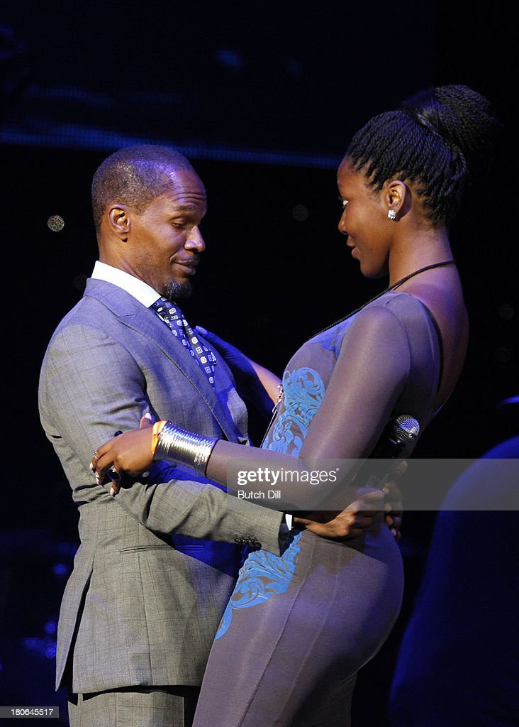 <a gi-track='captionPersonalityLinkClicked' href=/galleries/search?phrase=Jamie+Foxx&family=editorial&specificpeople=201715 ng-click='$event.stopPropagation()'>Jamie Foxx</a> gets a hug from a fan on stage during the BBVA Compass Concert for Human Rights hosted by <a gi-track='captionPersonalityLinkClicked' href=/galleries/search?phrase=Jamie+Foxx&family=editorial&specificpeople=201715 ng-click='$event.stopPropagation()'>Jamie Foxx</a> at the Birmingham Jefferson Convention Center on September 14, 2013 in Birmingham, Alabama.