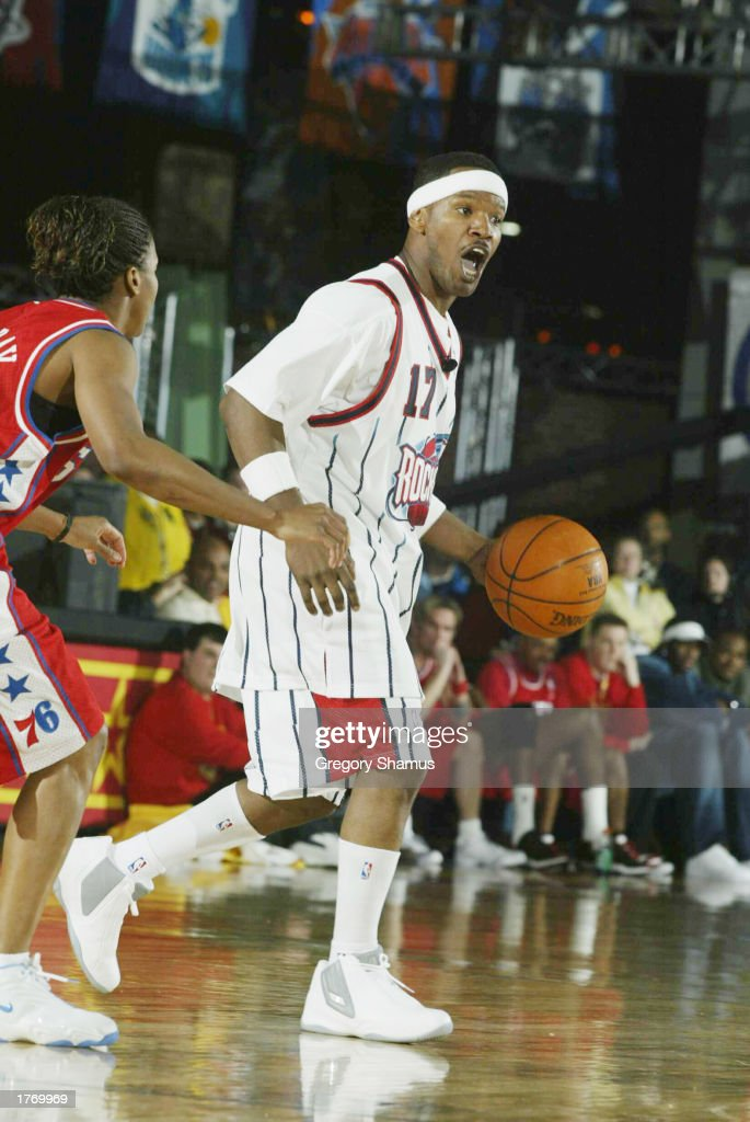 Jamie Foxx moves the ball upcourt during the Celebrity Game at NBA Jam Session during the 2003 NBA All Star Weekend at the Georgia World Congress...