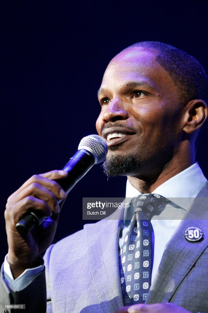 <a gi-track='captionPersonalityLinkClicked' href=/galleries/search?phrase=Jamie+Foxx&family=editorial&specificpeople=201715 ng-click='$event.stopPropagation()'>Jamie Foxx</a> performs during the BBVA Compass Concert for Human Rights hosted by <a gi-track='captionPersonalityLinkClicked' href=/galleries/search?phrase=Jamie+Foxx&family=editorial&specificpeople=201715 ng-click='$event.stopPropagation()'>Jamie Foxx</a> at the Birmingham Jefferson Convention Center on September 14, 2013 in Birmingham, Alabama.