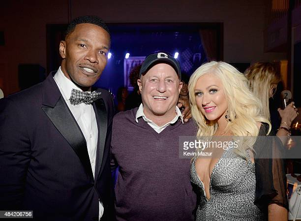Jamie Foxx Ronald O Perelman and Christina Aguilera attend Apollo in the Hamptons 2015 at The Creeks on August 15 2015 in East Hampton New York