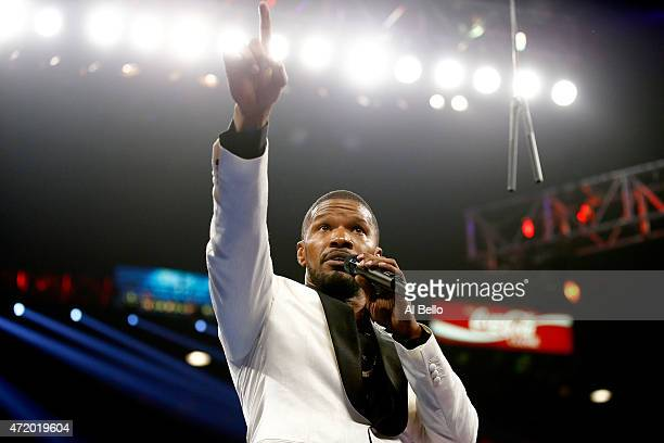 Jamie Foxx sings the national anthem of the United States of America before the welterweight unification championship bout between Floyd Mayweather...