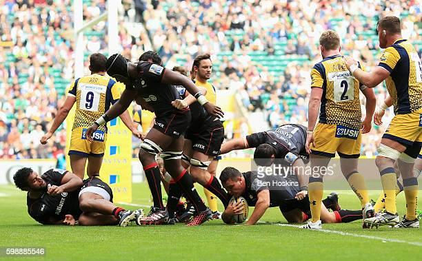 Jamie George of Saracens goes over to score the first try during the Aviva Premiership match between Saracens and Worcester Warriors at Twickenham...