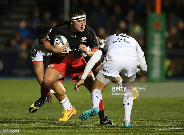 Jamie George of Saracens takes on Toby Flood during the European Rugby Champions Cup match between Saracens and Toulouse at Allianz Park on November...