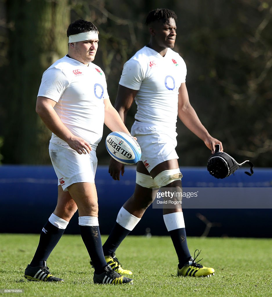 Jamie Geroge (L) looks on with team mate <a gi-track='captionPersonalityLinkClicked' href=/galleries/search?phrase=Maro+Itoje&family=editorial&specificpeople=5967858 ng-click='$event.stopPropagation()'>Maro Itoje</a> during the England training session held at Pennyhill Park on February 12, 2016 in Bagshot, England.