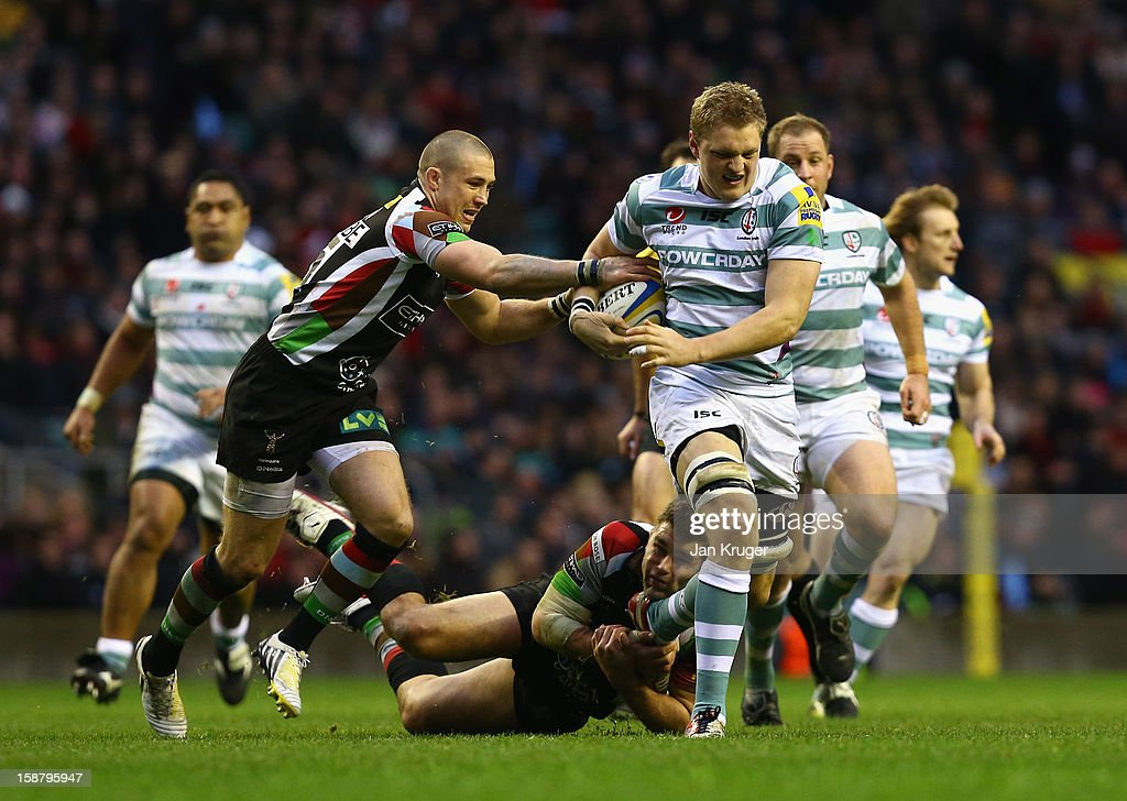 Jamie Gibson of London Irish is tackled by Mike Brown (L) and <a gi-track='captionPersonalityLinkClicked' href=/galleries/search?phrase=Nick+Easter&family=editorial&specificpeople=686040 ng-click='$event.stopPropagation()'>Nick Easter</a> of Harlequins during the Aviva Premiership match between Harlequins and London Irish at Twickenham Stadium on December 29, 2012 in London, England.