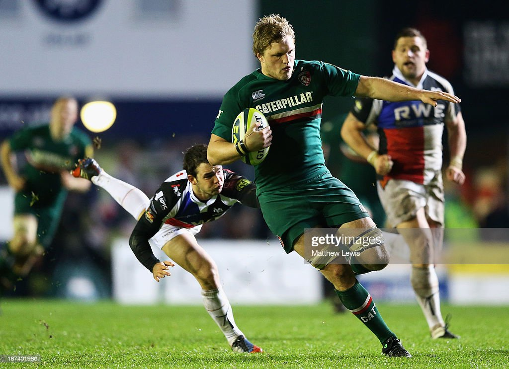 Jamie Gibson of the Leicester Tigers breaks through the tackle of Tom Haberfield of the Ospreys during the LV=Cup match between Leicester Tigers and Ospreys at Welford Road on November 8, 2013 in Leicester, England.