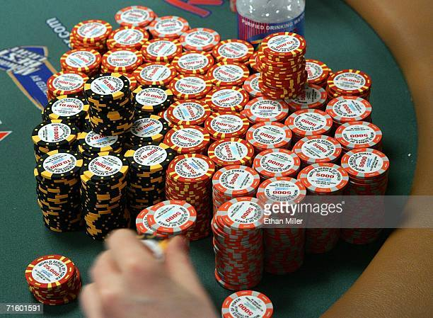 Jamie Gold of California gathers a stack of chips as he competes in the World Series of Poker nolimit Texas Hold 'em main event at the Rio Hotel...