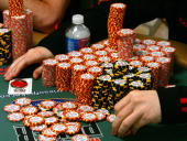 Jamie Gold of California organizes his chips while competing in the World Series of Poker nolimit Texas Hold 'em main event at the Rio Hotel Casino...