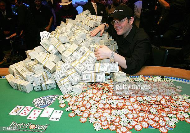 Jamie Gold of California poses with the USD 12 million he won in the World Series of Poker nolimit Texas Hold 'em main event at the Rio Hotel Casino...