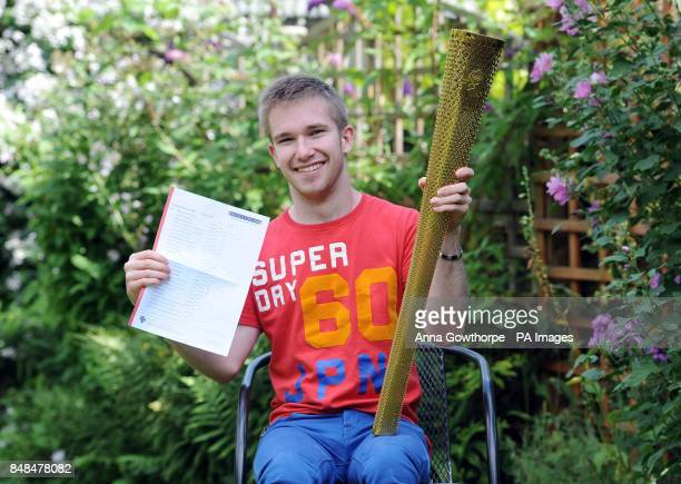 Jamie Green from Malton North Yorkshire celebrates getting three A*s and two As today in his ALevel results and holds his Olympic torch which he...