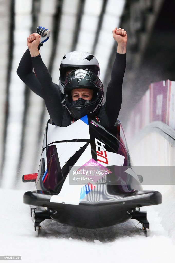 Jamie Greubel and Aja Evans of the United States team 2 celebrate during the Women's Bobsleigh on Day 12 of the Sochi 2014 Winter Olympics at Sliding...