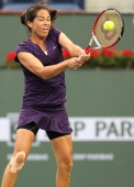 Jamie Hampton hits a return to Bethanie MattekSands during day 2 of the BNP Paribas Open at Indian Wells Tennis Garden on March 7 2013 in Indian...