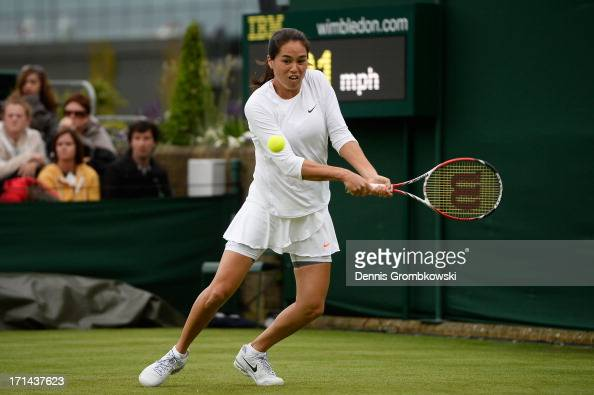 Jamie Hampton of the United States of America plays a backhand during her Ladies' Singles first round match against Sloane Stephens of United States...