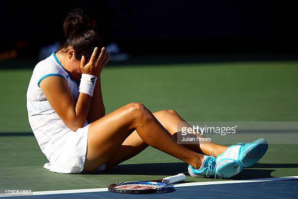Jamie Hampton of the United States reacts after an injury against Elena Baltacha of Great Britain during Day Two of the 2011 US Open at the USTA...