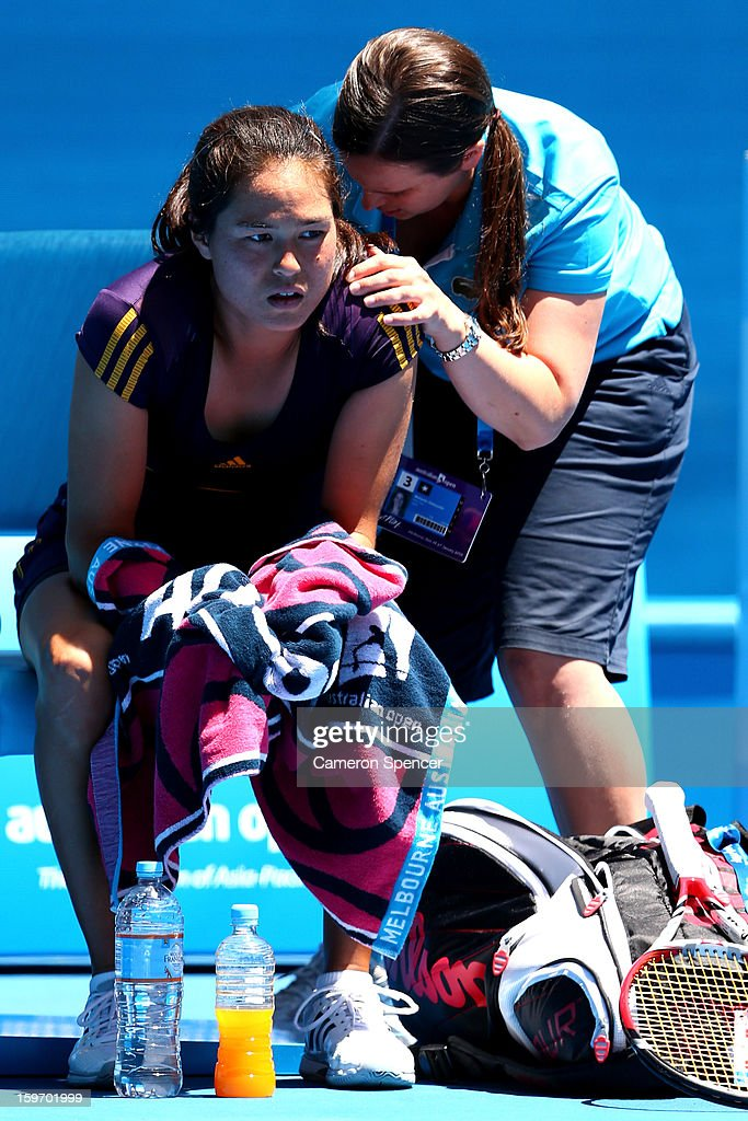 Jamie Hampton of the United States receives medical attention in her third round match against Victoria Azarenka of Belarus during day six of the 2013 Australian Open at Melbourne Park on January 19, 2013 in Melbourne, Australia.