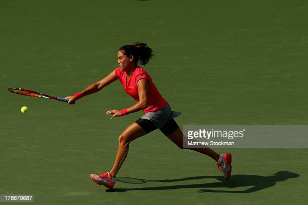 Jamie Hampton of the United States returns a shot during her women's singles third round match against Sloane Stephens of the United States on Day...