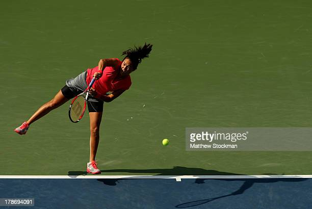 Jamie Hampton of the United States serves during their women's singles third round match Sloane Stephens of the United States on Day Five of the 2013...