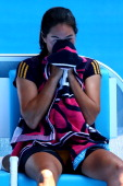 Jamie Hampton of the United States towels off in her third round match against Victoria Azarenka of Belarus during day six of the 2013 Australian...