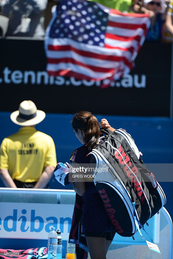 Jamie Hampton of the US walks off court after defeat in her women's singles match against Belarus's Victoria Azarenka on the sixth day of the Australian Open tennis tournament in Melbourne on January 19, 2013.