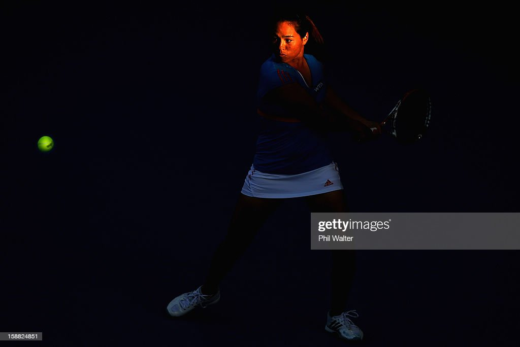 <a gi-track='captionPersonalityLinkClicked' href=/galleries/search?phrase=Jamie+Hampton&family=editorial&specificpeople=5534487 ng-click='$event.stopPropagation()'>Jamie Hampton</a> of the USA plays a backhand in her first round match against Jie Zheng of China during day one of the 2013 ASB Classic on December 31, 2012 in Auckland, New Zealand.