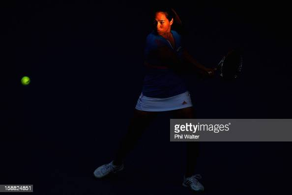 Jamie Hampton of the USA plays a backhand in her first round match against Jie Zheng of China during day one of the 2013 ASB Classic on December 31...