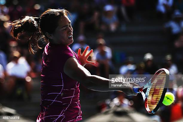 Jamie Hampton of the USA plays a forehand against Tamira Paszek of Austria during day one of the ASB Classic at ASB Tennis Centre on December 30 2013...