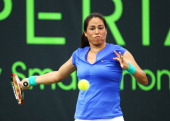 Jamie Hampton of the USA returns a shot to Carla Suarez Navarro Spain during day 5 of the Sony Open at the Crandon Park Tennis Center on March 22...
