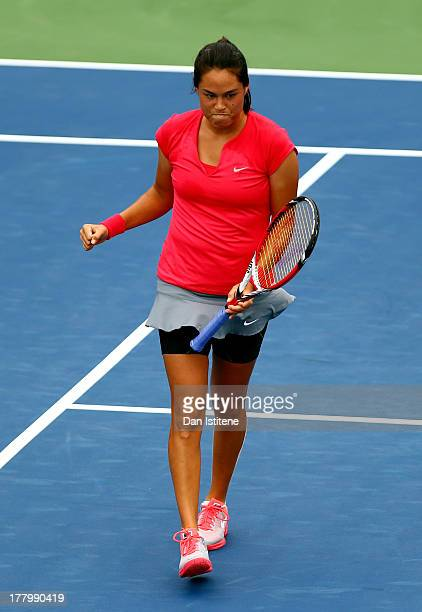 Jamie Hampton of United States of America celebrates the first set point against Lara Arruabarrena of Spain during their first round match on Day One...