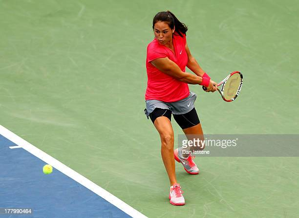 Jamie Hampton of United States of America plays a backhand against Lara Arruabarrena of Spain during their first round match on Day One of the 2013...