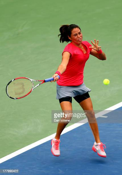 Jamie Hampton of United States of America plays a forehand against Lara Arruabarrena of Spain during their first round match on Day One of the 2013...