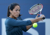 Jamie Hampton returns a shot to Agnieszka Radwanska of Poland during their semifinal match on Day 6 of the Bank of the West Classic at Stanford...
