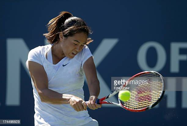 Jamie Hampton returns a shot to Vera Dushevina of Russia during their match on Day 5 of the Bank of the West Classic at Stanford University Taube...