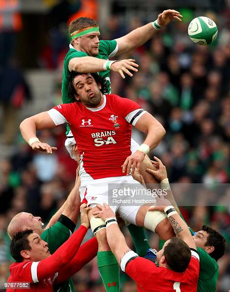 Jamie Heaslip of Ireland beats Jonathan Thomas of Wales to a lineout ball during the RBS Six Nations match between Ireland and Wales at Croke Park...