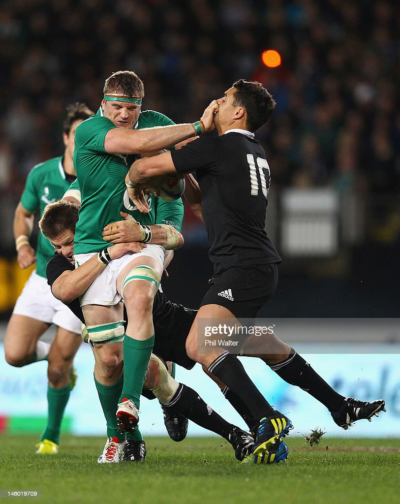 <a gi-track='captionPersonalityLinkClicked' href=/galleries/search?phrase=Jamie+Heaslip&family=editorial&specificpeople=171469 ng-click='$event.stopPropagation()'>Jamie Heaslip</a> of Ireland fends off <a gi-track='captionPersonalityLinkClicked' href=/galleries/search?phrase=Dan+Carter+-+Rugby+Player&family=editorial&specificpeople=171299 ng-click='$event.stopPropagation()'>Dan Carter</a> of the All Blacks during the International Test Match between the New Zealand All Blacks and Ireland at Eden Park on June 9, 2012 in Auckland, New Zealand.