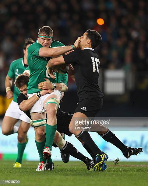 Jamie Heaslip of Ireland fends off Dan Carter of the All Blacks during the International Test Match between the New Zealand All Blacks and Ireland at...
