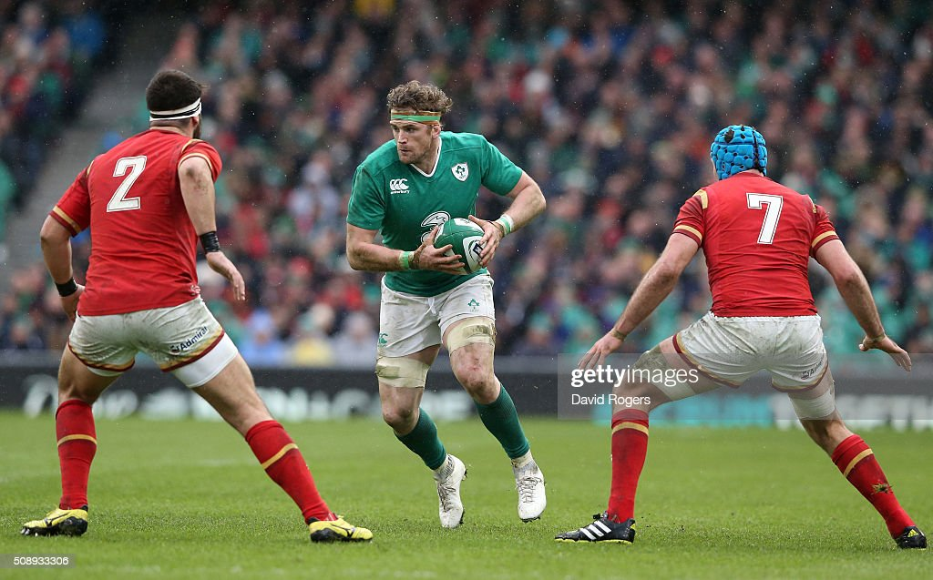<a gi-track='captionPersonalityLinkClicked' href=/galleries/search?phrase=Jamie+Heaslip&family=editorial&specificpeople=171469 ng-click='$event.stopPropagation()'>Jamie Heaslip</a> of Ireland is closed down by Scott Baldwin and <a gi-track='captionPersonalityLinkClicked' href=/galleries/search?phrase=Justin+Tipuric&family=editorial&specificpeople=6739194 ng-click='$event.stopPropagation()'>Justin Tipuric</a> of Wales during the RBS Six Nations match between Ireland and Wales at the Aviva Stadium on February 7, 2016 in Dublin, Ireland.