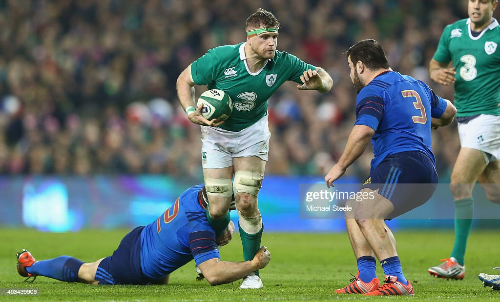 Jamie Heaslip of Ireland is held up by Guilhem Guirado as Rabah Slimani of France closes in during the RBS Six Nations match between Ireland and...