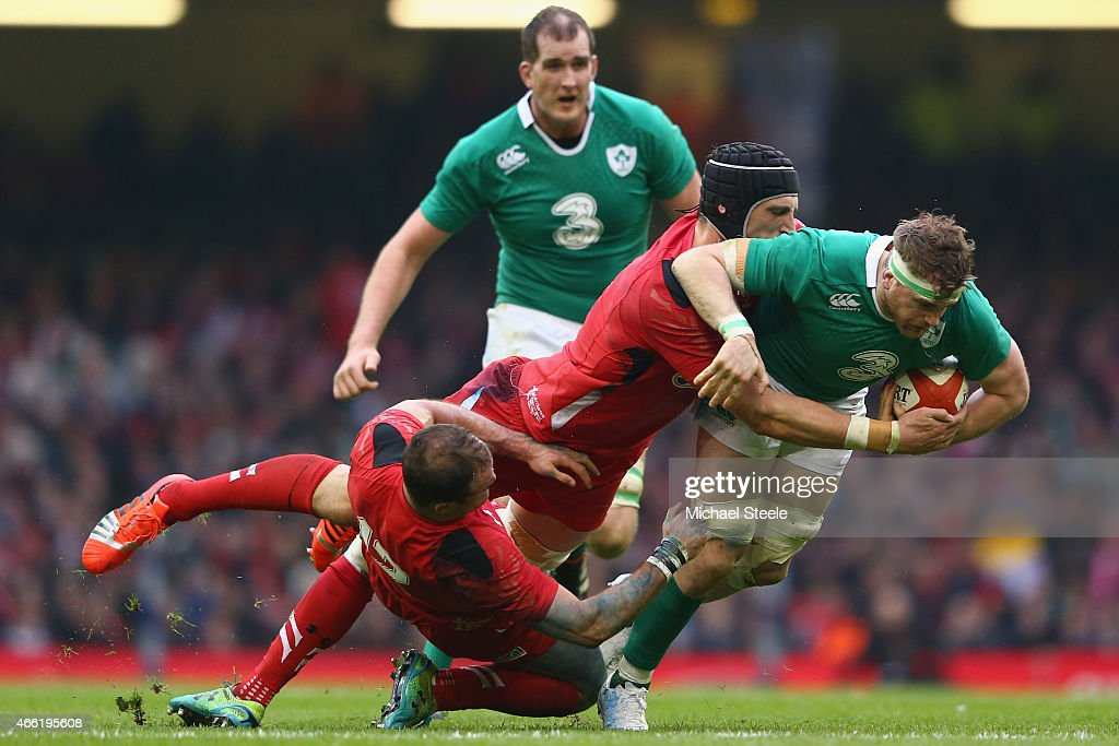 Jamie Heaslip of Ireland is held up by Luke Charteris and Jamie Roberts of Wales during the RBS Six Nations match between Wales and Ireland at the...