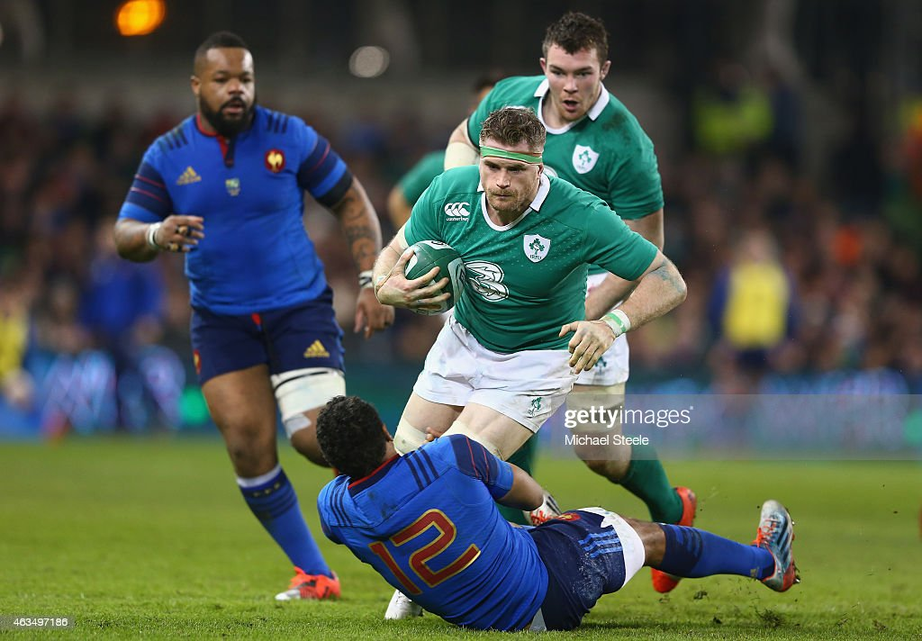 Jamie Heaslip of Ireland is in control as Wesley Fofana of France challenges during the RBS Six Nations match between Ireland and France at the Aviva...