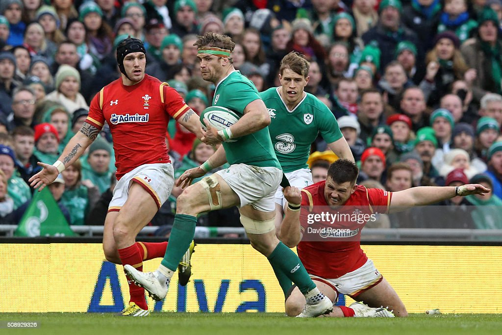 <a gi-track='captionPersonalityLinkClicked' href=/galleries/search?phrase=Jamie+Heaslip&family=editorial&specificpeople=171469 ng-click='$event.stopPropagation()'>Jamie Heaslip</a> of Ireland is snagged by Rob Evans of Wales during the RBS Six Nations match between Ireland and Wales at the Aviva Stadium on February 7, 2016 in Dublin, Ireland.