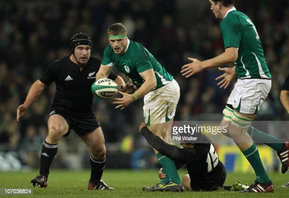 Jamie Heaslip of Ireland is tackled by Mils Muliaina of the All Blacks during the Test match between Ireland and the New Zealand All Blacks at Aviva...