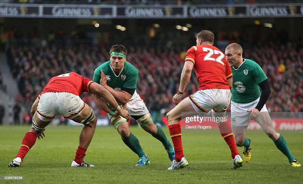 <a gi-track='captionPersonalityLinkClicked' href=/galleries/search?phrase=Jamie+Heaslip&family=editorial&specificpeople=171469 ng-click='$event.stopPropagation()'>Jamie Heaslip</a> of Ireland is tackled by <a gi-track='captionPersonalityLinkClicked' href=/galleries/search?phrase=Taulupe+Faletau&family=editorial&specificpeople=12444794 ng-click='$event.stopPropagation()'>Taulupe Faletau</a> of Wales during the RBS Six Nations match between Ireland and Wales at the Aviva Stadium on February 7, 2016 in Dublin, Ireland.