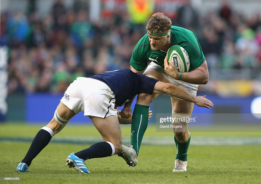 Jamie Heaslip of Ireland is tackled during the RBS Six Nations match between Ireland and Scotland at the Aviva Stadium on February 2, 2014 in Dublin, Ireland.