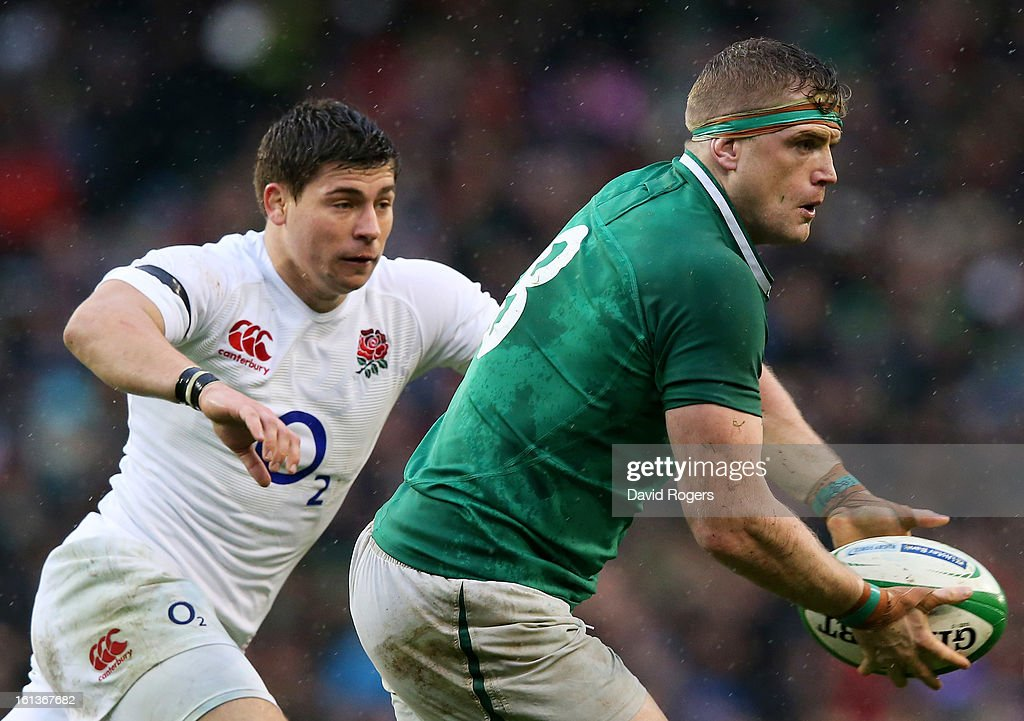 Jamie Heaslip of Ireland looks to pass as Ben Youngs of England closes in during the RBS Six Nations match between Ireland and England at Aviva Stadium on February 10, 2013 in Dublin, Ireland.